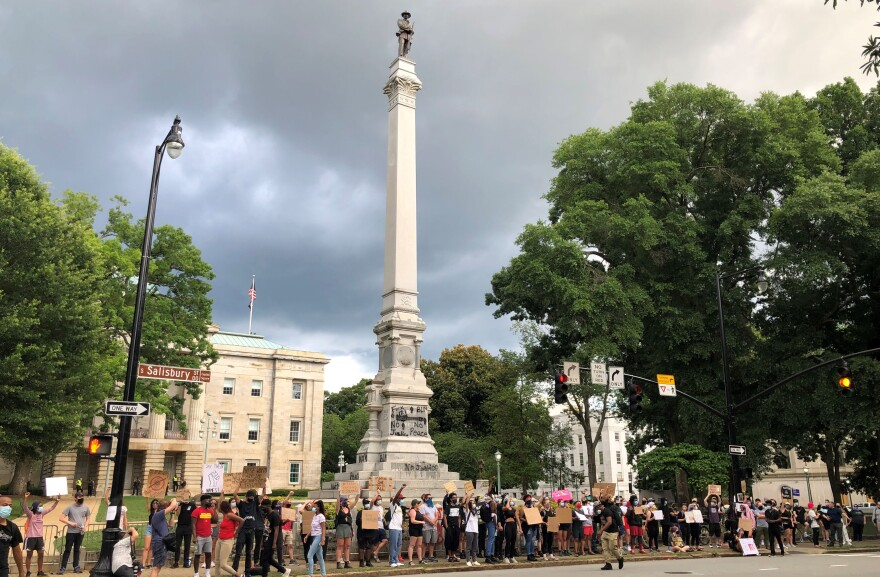 Protesters gathered near this Confederate monument in Raleigh on Saturday, June 20. Crews began removing the monument on Sunday.