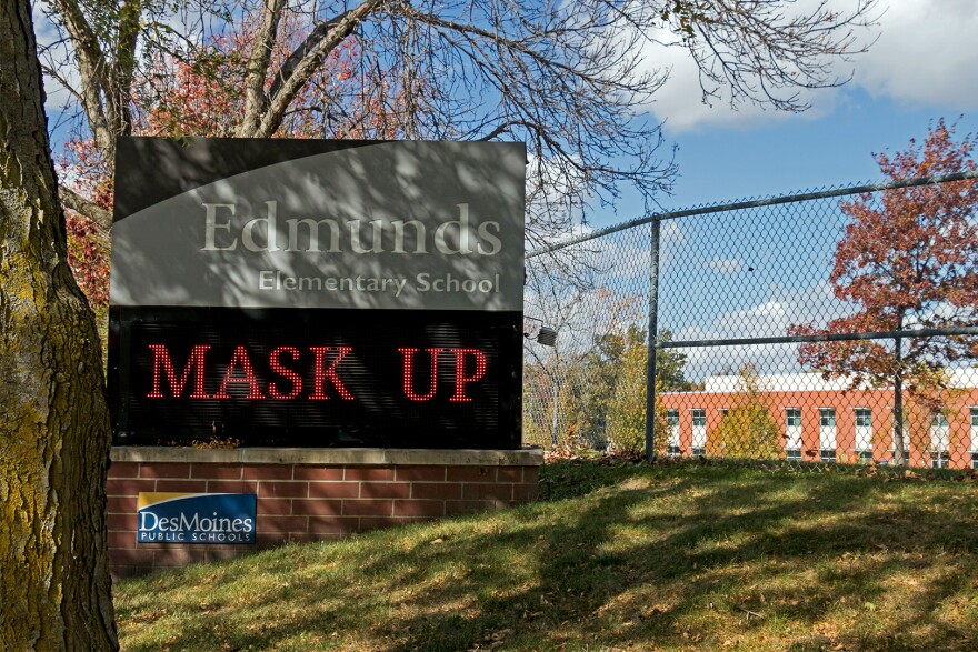 """A digital sign outside of Edmunds Elementary in Des Moines encourages students to """"mask up."""""""