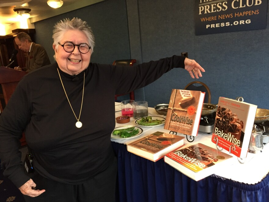 """Shirley Corriher with her two cookbooks, which she calls """"my babies,"""" at the National Press Club on Oct. 22."""