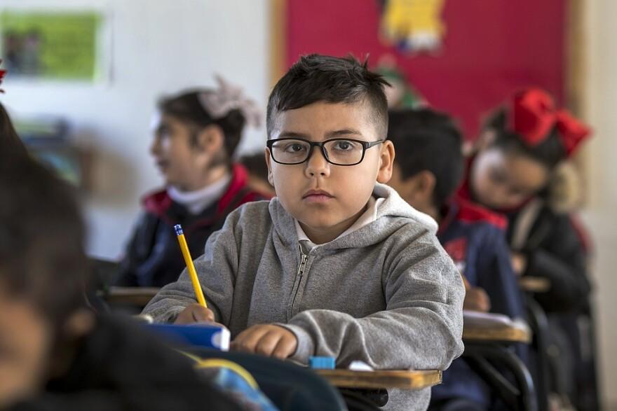 Classroom kid looking at us school.jpg