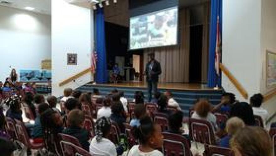 """Gangsta Gardener"" Ron Finley talks to students at C.A. Weis Elementary School, which has a high poverty rate, about gardening as a source for healthy food."