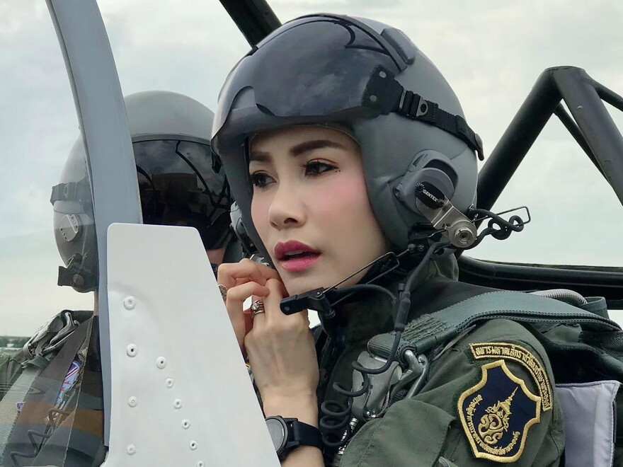 An undated photo posted Aug. 26, 2019, on the Thailand Royal Office website shows Maj. Gen. Sineenatra Wongvajirabhakdi, then the royal noble consort of King Maha Vajiralongkorn, in an aircraft cockpit. Late Monday, it was announced that Sineenatra was stripped of her titles and military ranks for disloyalty.