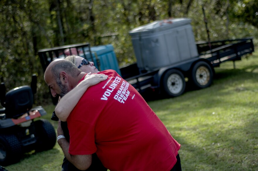 Operation BBQ Relief provides meals to displaced residents and emergency personnel during times of natural and other disasters. Above, David Marks, head of marketing for the group, shares a hug with a woman during relief operations in Wilmington, N.C., last year.