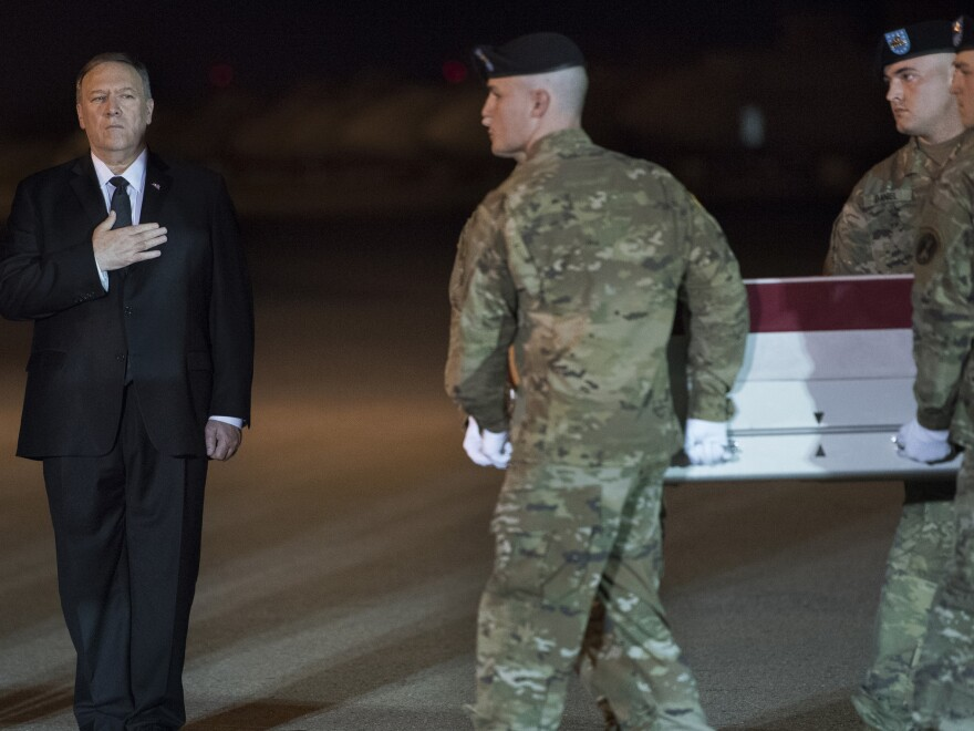 An Army carry team moves a transfer case containing the remains of Sgt. 1st Class Elis Barreto Ortiz, 34, past Secretary of State Mike Pompeo. Ortiz was killed in action last week when an improvised explosive device detonated near his vehicle in Kabul, Afghanistan.