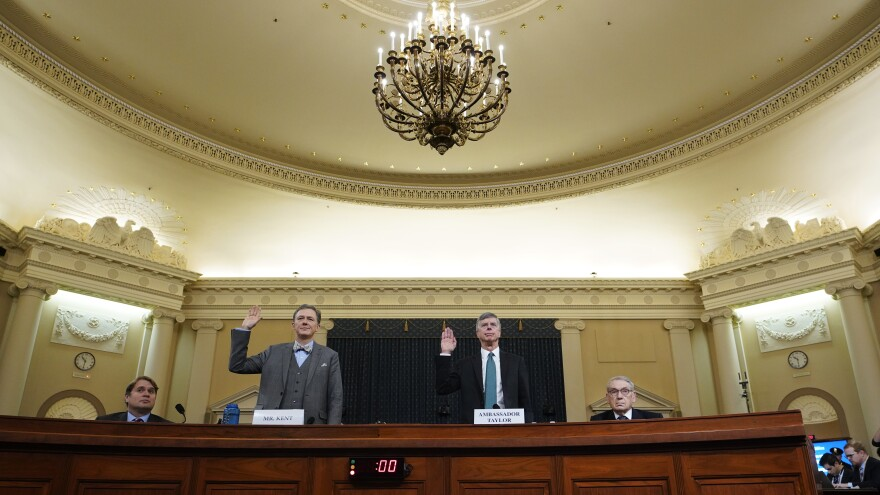 Deputy Assistant Secretary for European and Eurasian Affairs George Kent and top U.S. diplomat in Ukraine William Taylor are sworn in prior to testifying before the House Intelligence Committee on Wednesday.