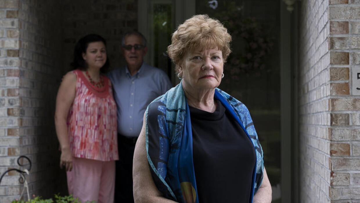 Celeste Marx, center, spent three weeks at St. Luke's Hospital in Chesterfield after testing positive for the coronavirus. Her daughter, Lisa, and husband Len, shown in the background, waited anxiously at home.