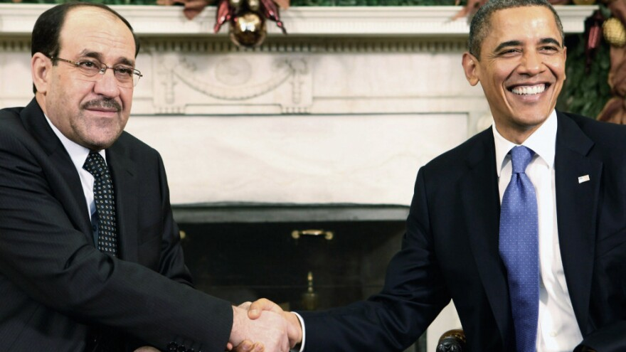 Iraqi Prime Minister Nouri al-Maliki shakes hands with President Obama in the Oval Office at the White House on Monday. The two leaders met as the U.S. prepares to withdraw the last of its combat troops from Iraq.