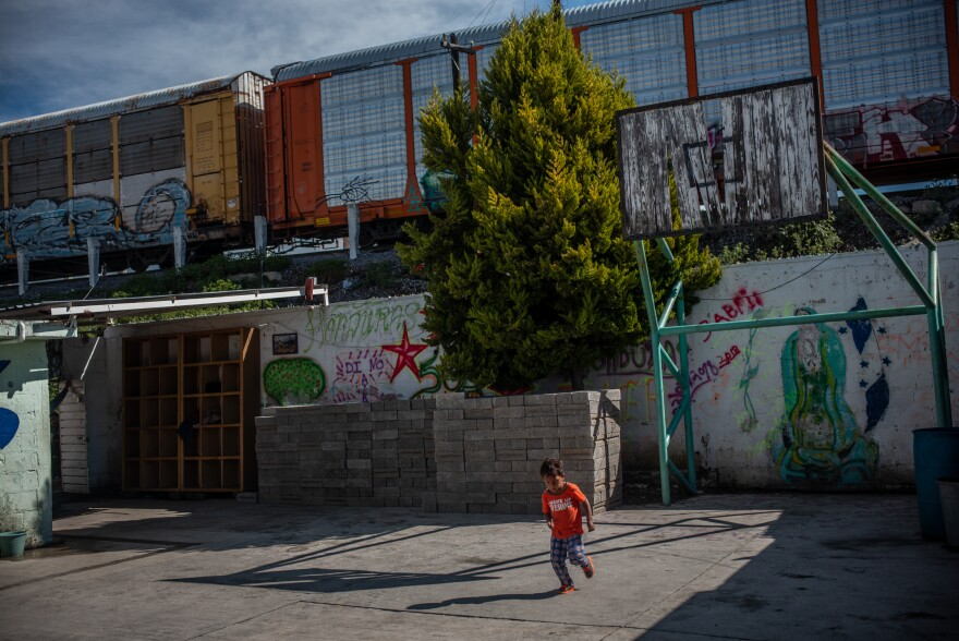 "The train known as ""The Beast"" passes by the Sagrada Familia shelter in Apizaco, Mexico. For many migrants, the train is the next step in their journey north."