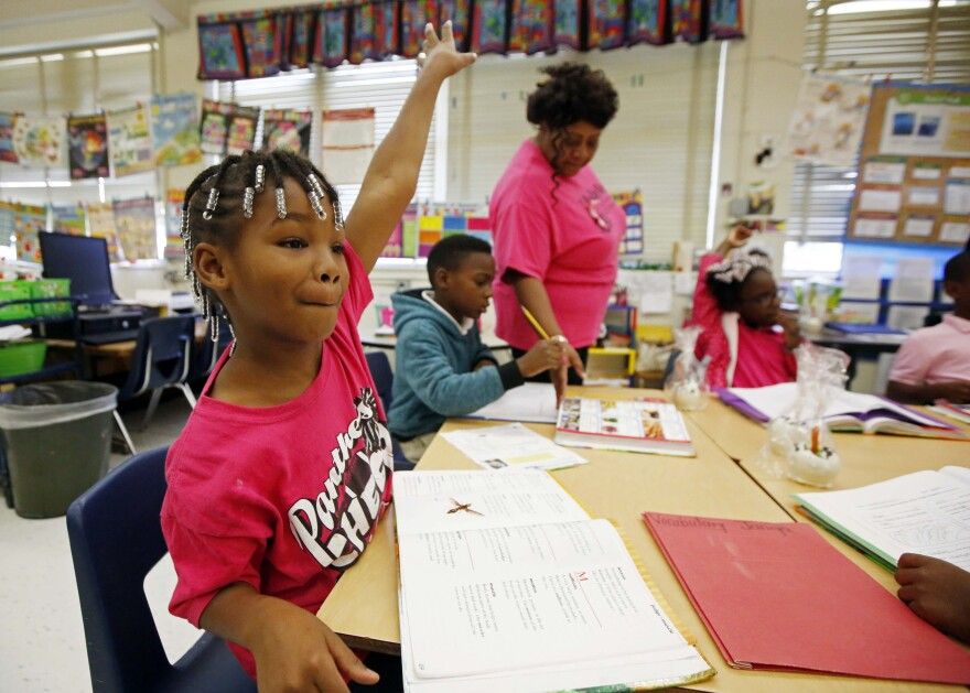 Walton Elementary second-grader Janiya Smith asks to be called on at the Jackson, Miss., school. Voters in the state rejected an initiative to increase funding for Mississippi's public schools.