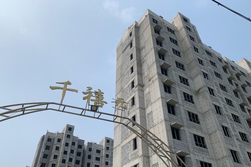 New high-rise apartments are under construction in villages around Heze, in eastern China's Shandong province. Rural residents say these complexes are too expensive, too far away from their fields and ill-suited for farmers.