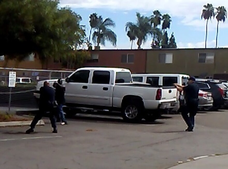 Police in El Cajon, Calif., provided this image, which they say is a still from a bystander's cellphone video of the shooting of Alfred Olango on Tuesday. Police say the man was pointing an object — which turned out not to be a weapon — at an officer.