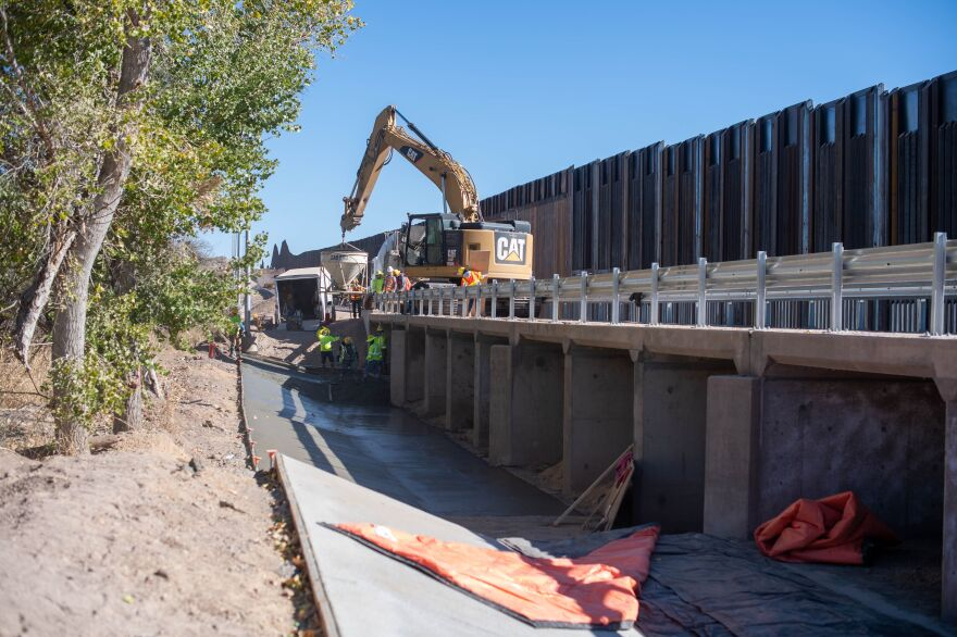 Contractors are building concrete culverts across creekbeds on the border.  Property owners warn the steel bollard wall across the creeks will catch debris and worsen flooding.