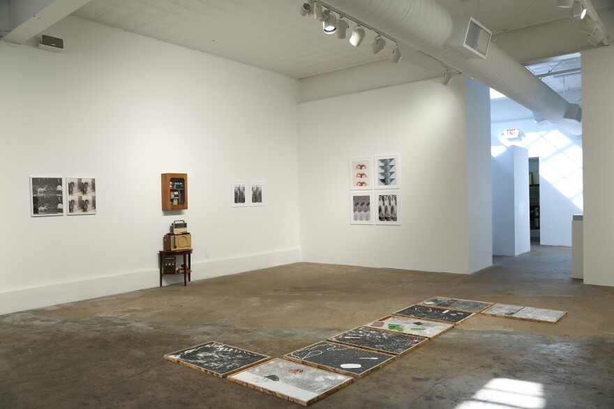 Installation view of Almost Now, Just Then depicts Kahlil Irving's detritus prints and images on the wall