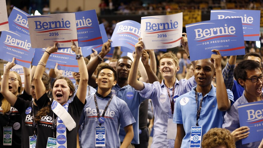 Supporters of Democratic presidential candidate Sen. Bernie Sanders, I-Vt., cheer the candidate at the New Hampshire Democratic convention Saturday.