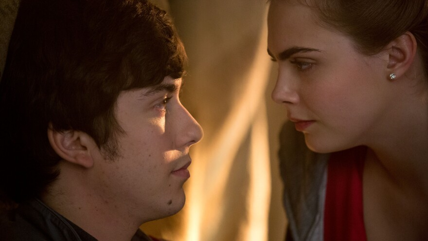 Nat Wolff and Margo Cara Delevingne in <em>Paper Towns</em>.