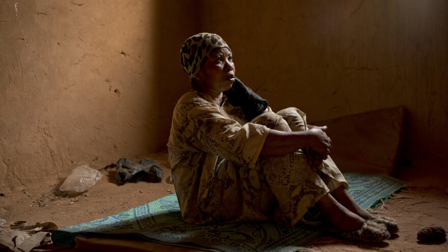 "Janet Kamara, who is from Liberia, sits during an interview conducted in an International Organization for Migration transit center in Arlit, Niger, on June 2. Kamara was expelled from Algeria and left stranded in the Sahara while pregnant. ""Our baby was killed; women were lying dead, men. ... Other people got missing in the desert because they didn't know the way,"" she told the AP."