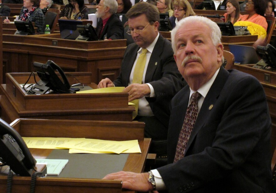 Kansas House Speaker Ray Merrick, a Republican, watches the chamber's electronic tally board as it approves a sweeping anti-abortion bill Friday at the Statehouse in Topeka. At left is Majority Leader Jene Vickrey.