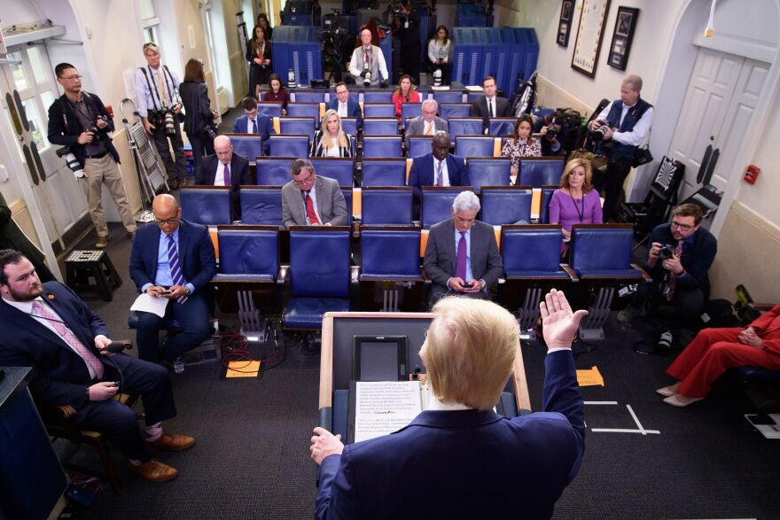 President Trump speaks during the daily coronavirus briefing at the White House on April 1.  Democratic groups have started to run ads aimed at countering Trump's daily briefings.