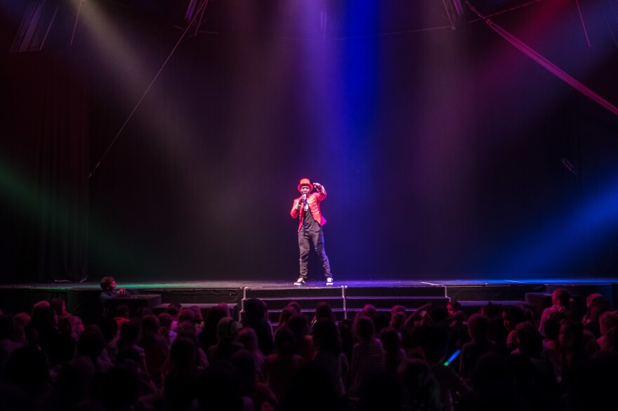 An emcee addresses a sellout crowd at the Zip Zap dome during a 2019 performance.