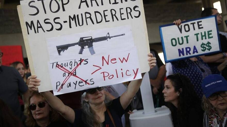 People protest against guns on the steps of the federal courthouse on February 17, 2018 in Fort Lauderdale, three days after the shooting at Marjory Stoneman Douglas High School that killed 17.