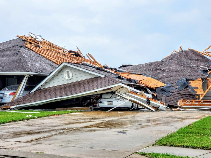 Damaged buildings and vehicles are seen in the aftermath of a tornado in Monroe, La., on Sunday, in this still image obtained from social media.