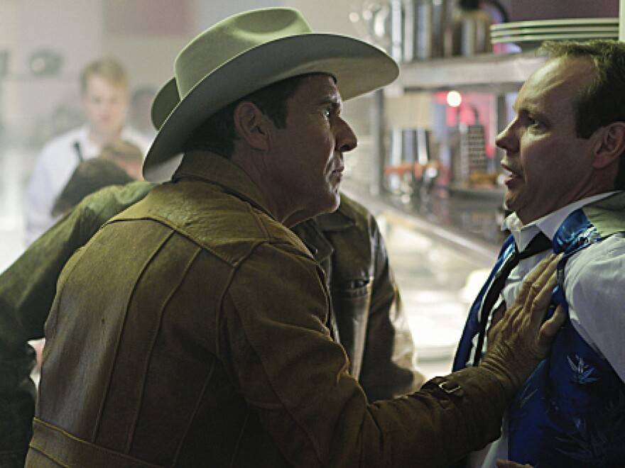 Sheriff Ralph Lamb (Dennis Quaid) questions a casino worker while investigating the murder of a craps dealer on the new CBS drama <em>Vegas</em>.