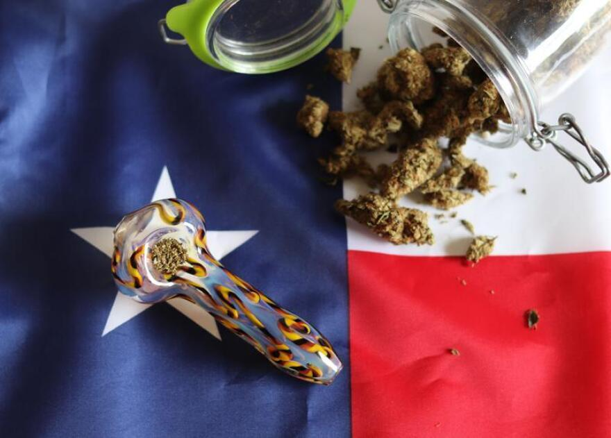 Marijuana and a pipe on a Texas flag