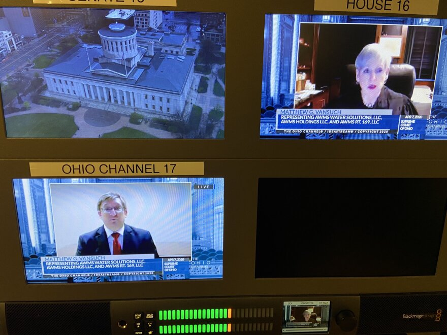Oral arguments for Tuesday's first case before the Ohio Supreme Court, as seen from a video monitor in the Statehouse News Bureau's office at the Statehouse.