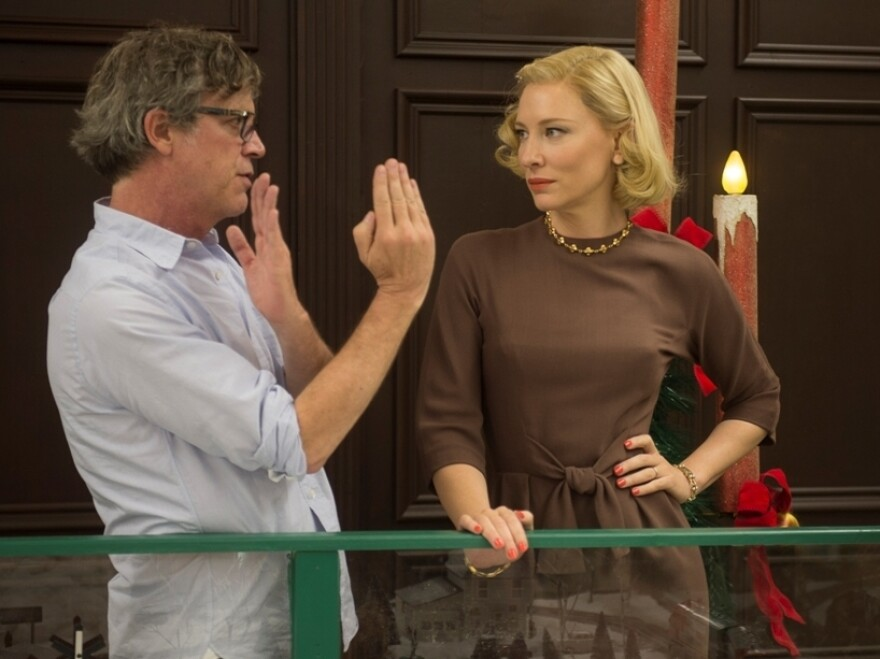 Director Todd Haynes works with actress Cate Blanchett on the set of <em>Carol</em>.