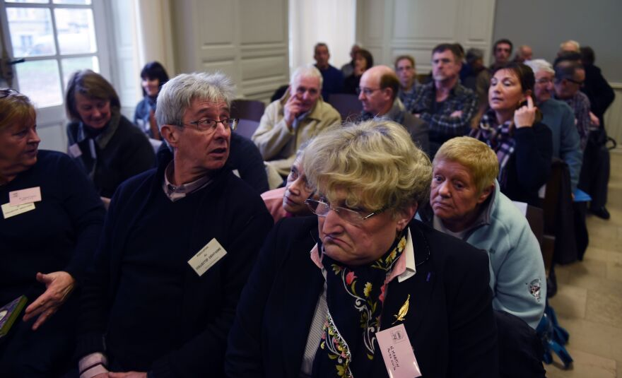 Victims await the start of the trial of Dutch dentist Jacobus Van Nierop on March 8 at the Nevers courthouse in central France. Van Nierop has since been sentenced to eight years behind bars.