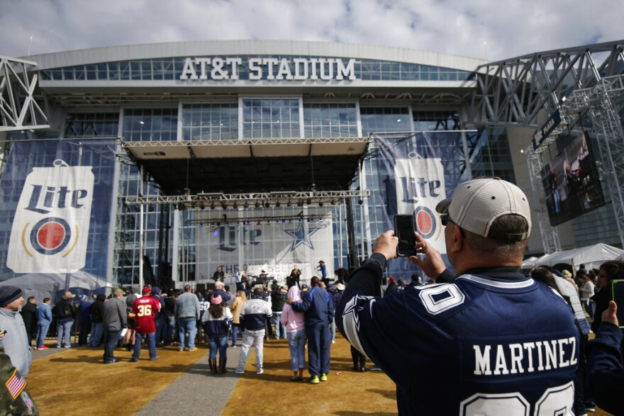 Fans arrive to AT&T Stadium for a game between the Dallas Cowboys and the Washington Redskins in Arlington 