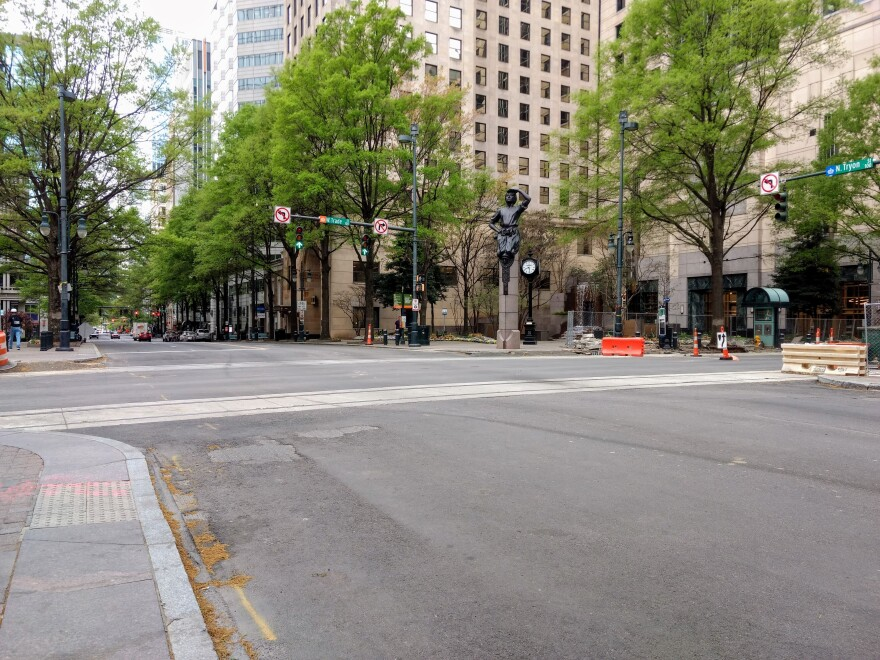 The square at Trade and Tryon streets uptown was deserted during morning rush hour Monday.