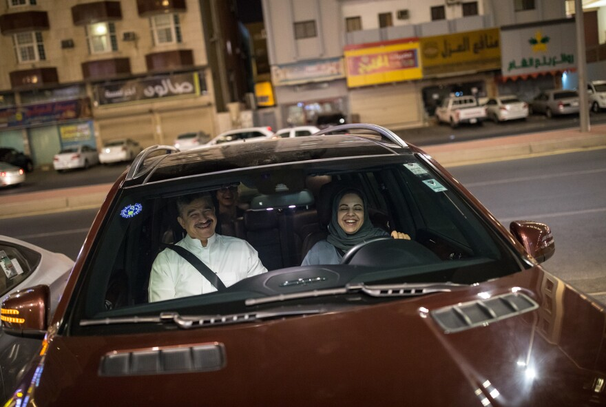 After midnight Sunday, Dania Alagili, 47, parks the car after taking her family out for a drive for the first time in the streets of Jeddah.
