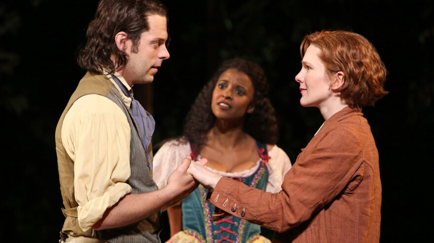 Orlando (David Furr), Rosalind (Lily Rabe, right) and Celia (Renee Elise Goldsberry) in <em>As You Like</em> <em>It</em>.<em> </em>The Public Theater's production opens the 50th-anniversary season at New York's Delacorte Theater.