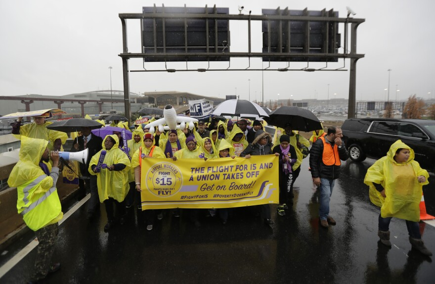 Service workers march at Newark Liberty International Airport in November 2016, asking for $15 minimum wage.