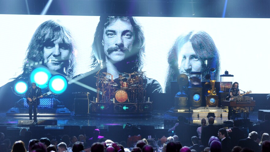 Rush on stage at the 2013 Rock and Roll Hall of Fame induction ceremony.