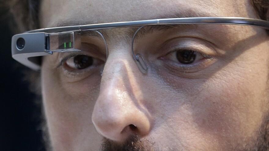 Google co-founder Sergey Brin wears Google Glass in February 2013.