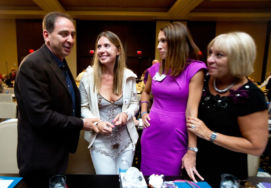 (From left) Tal and Giedre Cohen chat with Carrie Richardson and Mary Salter during a break at the Alzheimer's Association International Conference in Washington, D.C., on Saturday.