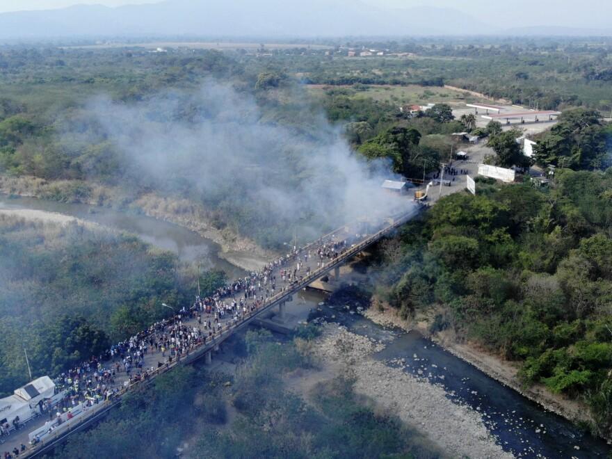 Smoke billows from aid trucks set on fire on the Francisco de Paula Santander International Bridge between Colombia and Venezuela, on Feb. 23.