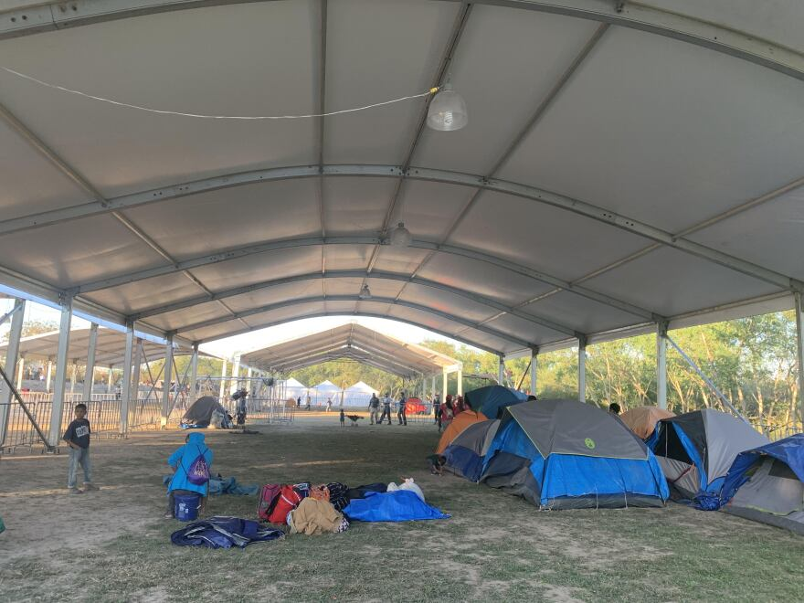Some asylum seekers have moved from a small plaza near the international bridge to large government tent structures near the Rio Grande in Matamoros, Mexico.