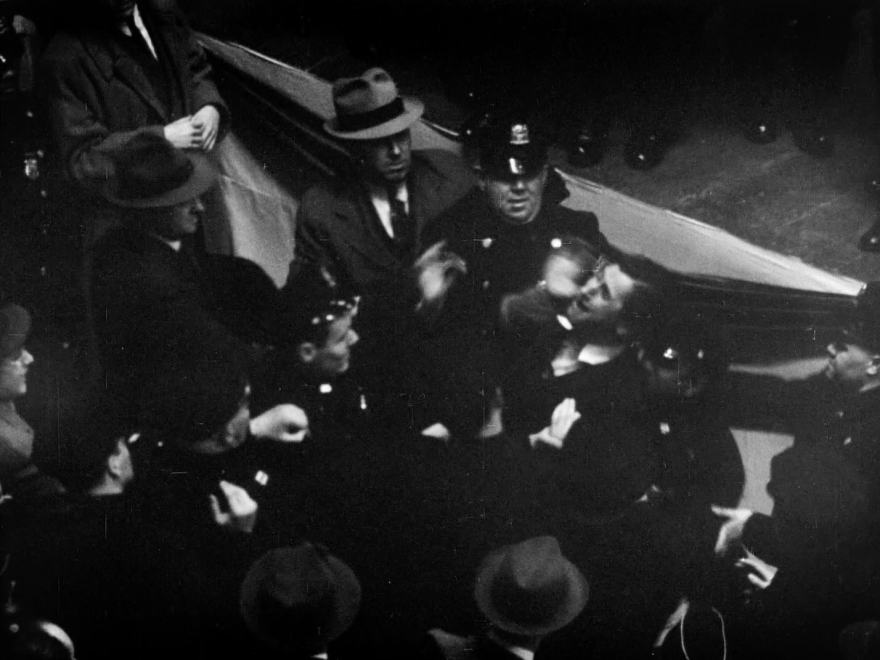 Isadore Greenbaum is carried off the stage by police after being punched and kicked by members of the German American Bund.