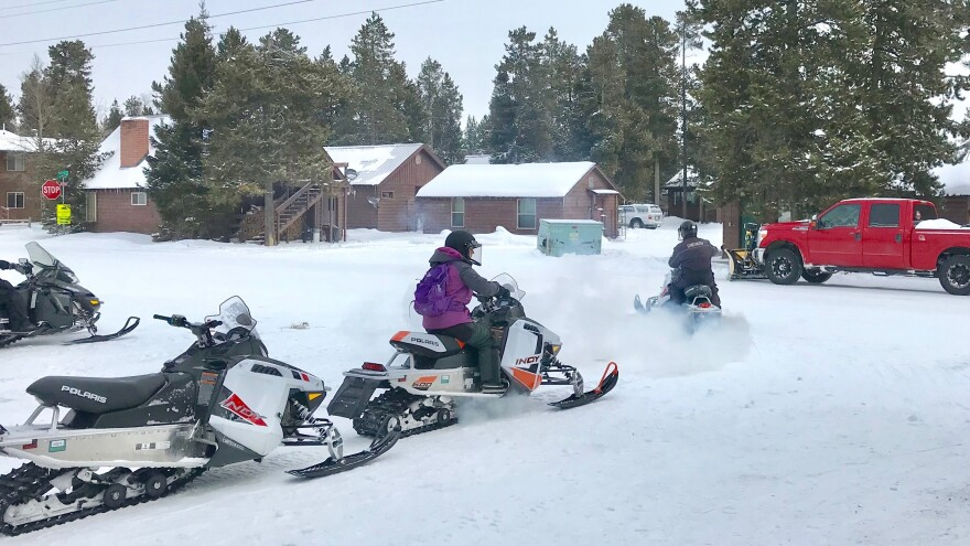 Between 20,000 to 30,000 people visit Yellowstone National Park each month in the winter, many to snowmobile the park's groomed roads and trails. To keep the park open during the shutdown, local hotels have teamed up with concessionaires to pay park employees to plow and groom roads, as well as to clean bathrooms.