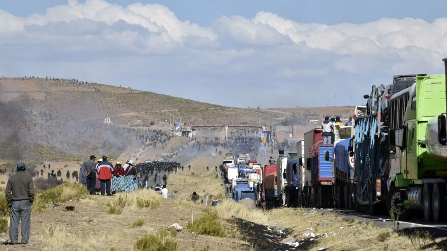 Smoke wafts over the highway linking the Bolivian capital of La Paz with the Chilean border during an ongoing clash between striking miners, who are blockading the road, and police.