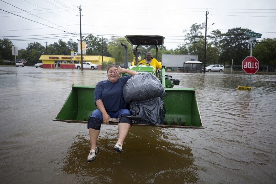 Christy Garcia was rescued from her Lakewood Community home by Mel Harris who used his John Deere tractor to pull hundreds of people out of their flooded homes.