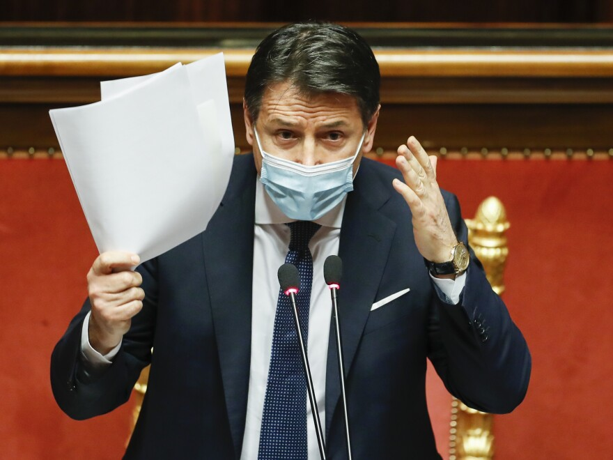 Italian Prime Minister Giuseppe Conte gestures as he replies to questions ahead of a confidence vote at the Senate on Jan. 19 at Palazzo Madama in Rome. Conte  handed in his resignation on Tuesday.