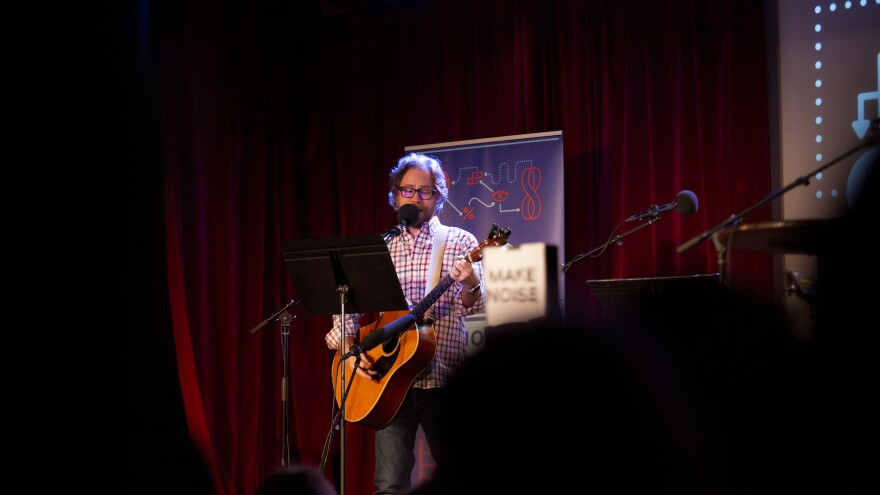 Jonathan Coulton leads a music parody game on <em>Ask Me Another</em> at the Bell House in Brooklyn, New York.