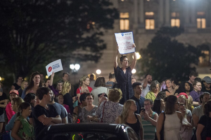 Supporters of House Democrats taking part in a sit-in in the House Chamber shout encouragement from outside the U.S. Capitol on Wednesday night.