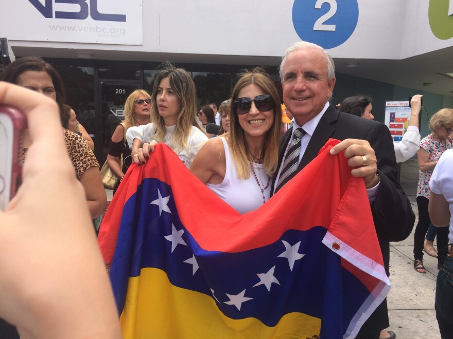 Miami-Dade County Mayor Carlos Gimenez poses with a Venezuelan
