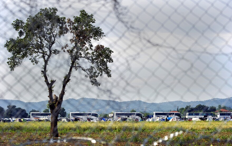 A picture taken from the Macedonian side of the border shows the evacuation of the camp near the Greek village of Idomeni. Many of the migrants and refugees were bused to camps farther south.