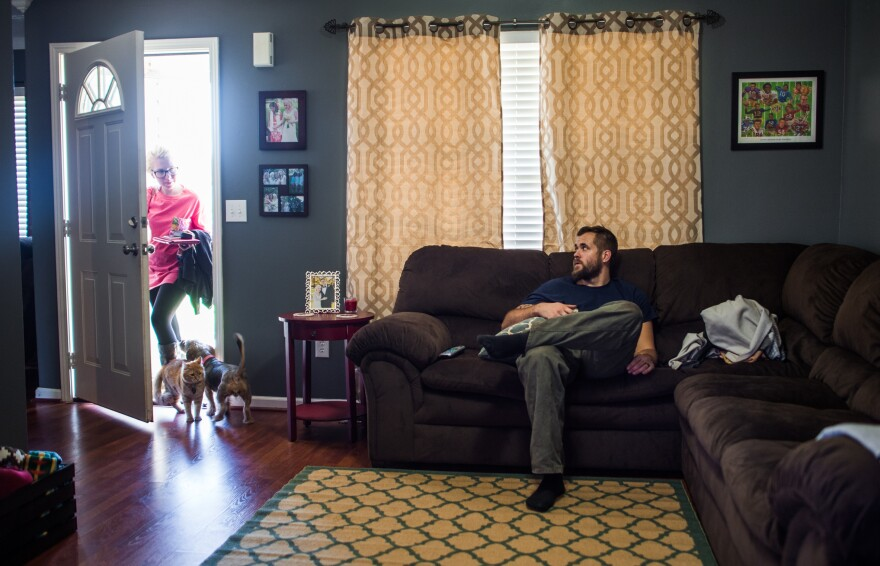Harris rests after his shift at Cooper Standard as his wife, Summer, gets home from work. Harris gets a few hours to have dinner and unwind before heading to class four days each week.